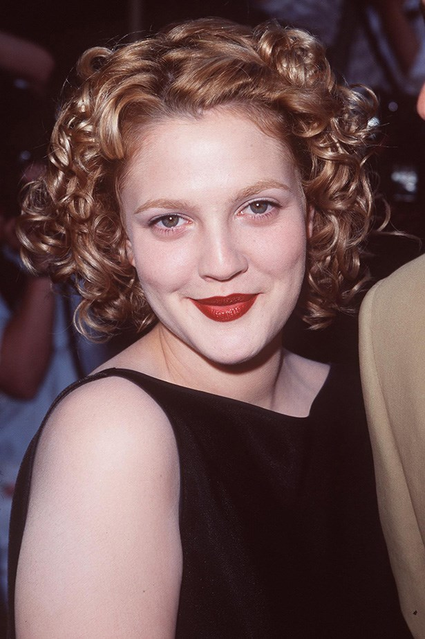 At the premiere of her romance, <em>Everafter</em> in 1998, the star curled her growing crop-hair into ringlets finishing her look with velvet red lipstick.