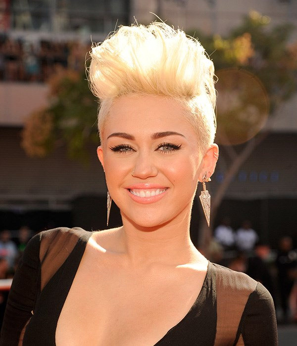 In 2012, Cyrus nearly broke the internet when she attended the 2012 MTV VMAs with her hair lobbed off and died peroxide blonde.