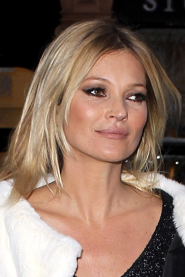 """To mark her 40th birthday and Playboy's 60th anniversary, <a href=""""http://http://www.elle.com.au/news/beauty-news/2013/12/kate-moss-st-tropez/"""">Moss posed for the magazine</a> in the buff. Here, she strolls to the signing event in London for the issue launch. No matter her age, lady still has swagger."""
