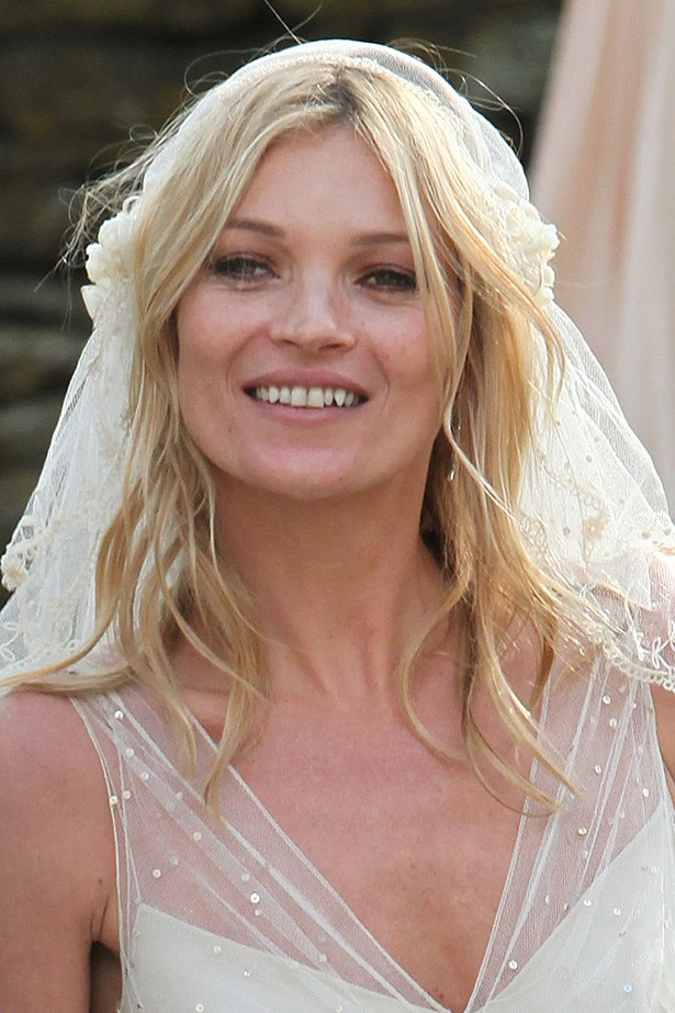 """The supermodel looked dreamy on her <a href=""""http://http://www.elle.com.au/fashion/celebrity-style/2013/9/something-custom-something-blue/kate-moss-and-jamie-hince/"""">wedding day</a> in 2011, where she married musician Jamie Hince and had 15 bridesmaids."""