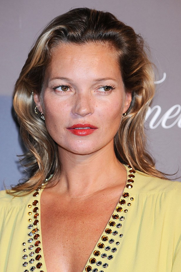 """Tanned and sporting a voluminous blow out, Moss was celebrated at Louis Vuitton's """"Timeless Muses"""" Exhibition in 2013."""