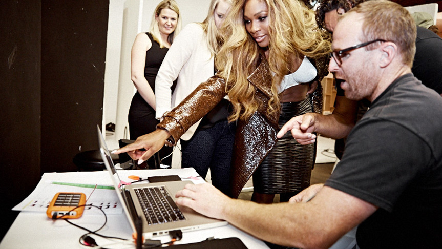 Serena Williams looks through her images with photographer on Berlie bra campaign shoot