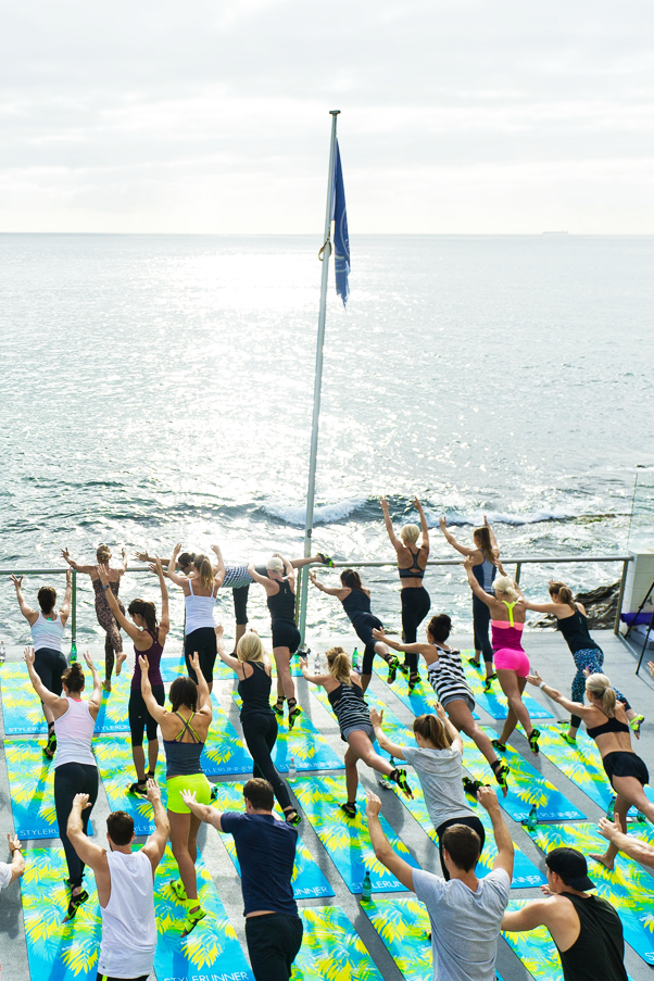 Chic yogis stretched out early at Bondi Beach with stylerunner.com