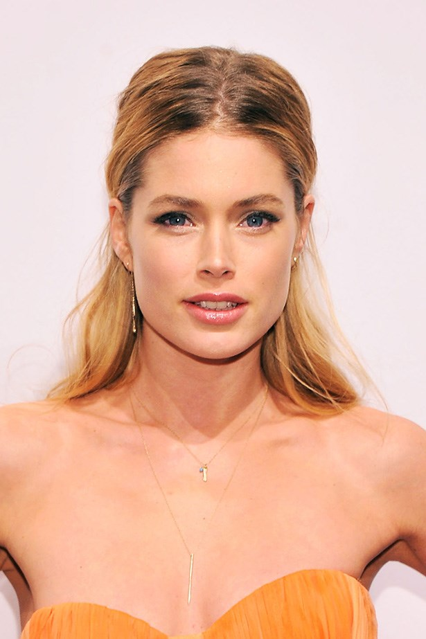 Wearing her hair in a low key half-up half down do, the beauty looked tanned and relaxed at another amfAR charity event in 2013.