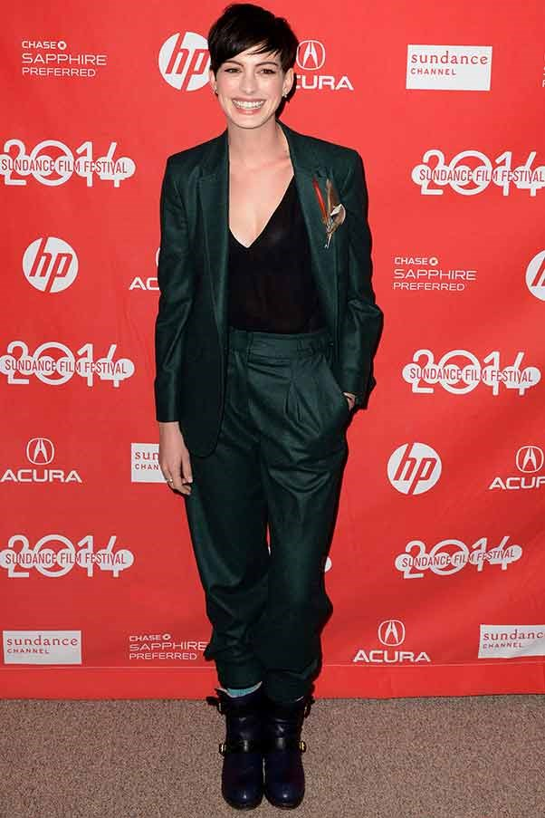 Taking a leaf out of Annie Hall's book, Anne Hathaway borrows from the boys in a rakish green suit. She's attending the première of 'Song One'.
