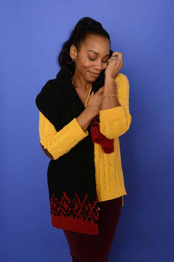 Anika Noni Rose can't resist snuggling her sweater at the photo call for 'Imperial Dreams'