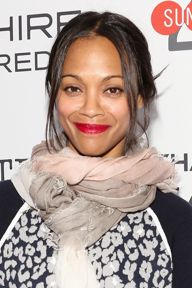 Zoe Saldana paired her messy low-bun with a shiny red lip at the <em>Infinitely Polar Bear</em> premiere party.