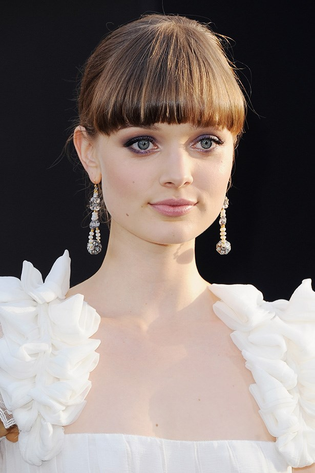 2012 was a monumental year for Heathcote, who starred in the major Hollywood picture, <em>Dark Shadows</em>, alongside Johnny Depp. At the Los Angeles premiere the rising star wore a feminine smoky eye and pearlescent lip gloss.
