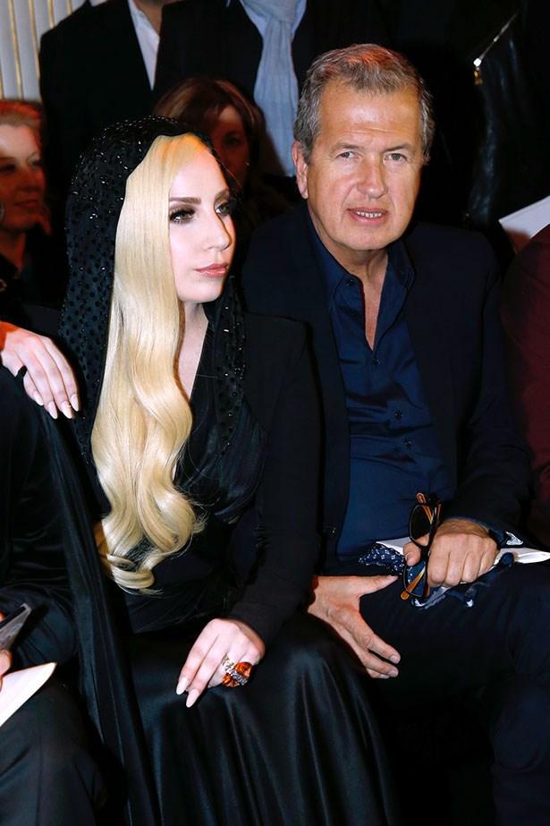 Lady Gaga and legendary photographer Mario Testino attend Atelier Versace