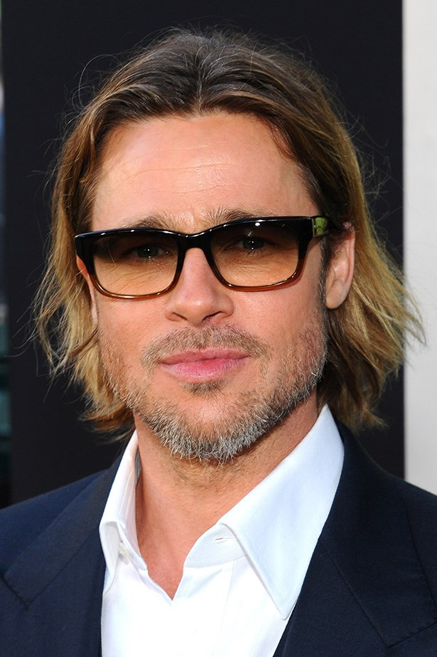 Dreamboat Brad Pitt wore his short, ombre crop tucked behind his ears at a Moneyball premiere.