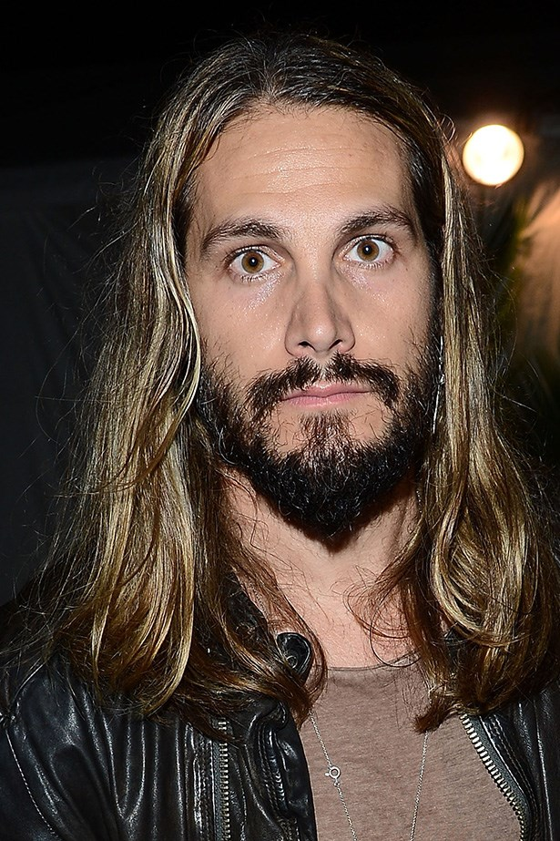 Marco Perego, artist, model and husband of Zoe Saldana, looks swarthy with ample facial hair and lothario locks.