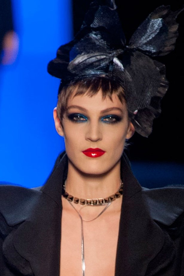Proving you can pair a strong lip with bold eyes, models at Jean Paul Gaultier wore deep crimson lips with smudged cobalt liner.