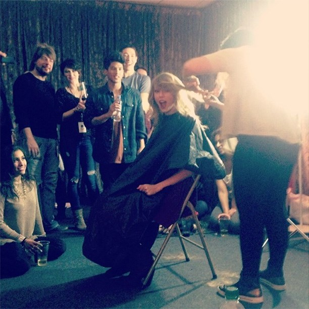 """Cara Delevingne was there to witness the snip, """"@taylorswift chopping off her locks ✂."""""""