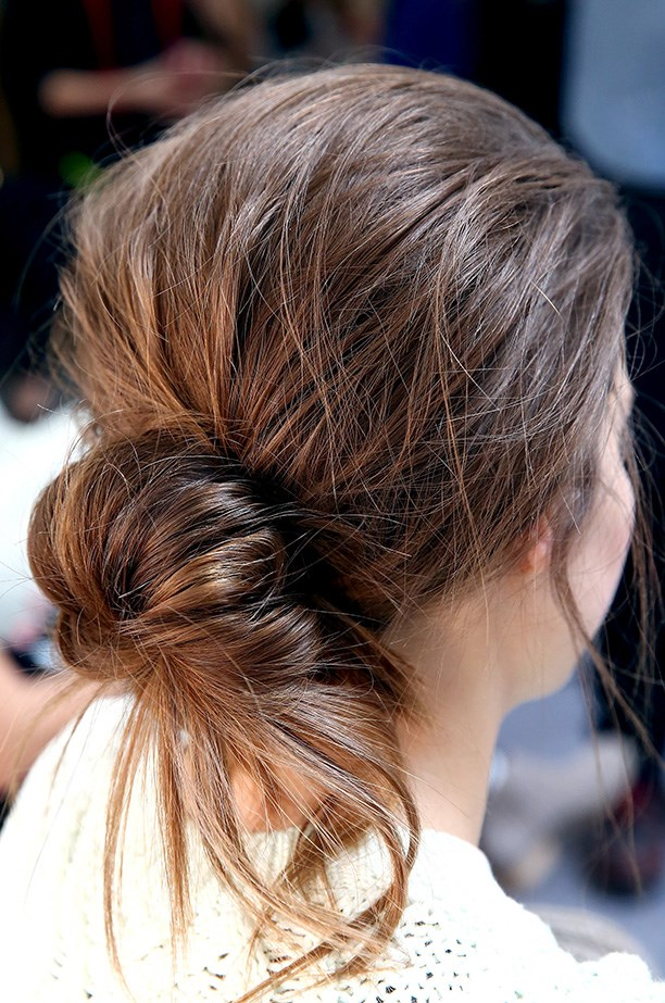 <strong>Sports luxe hair<BR></strong> Jenny Packham's post-gym scruffy bun was styled by Tresemme spokesperson, Jeanie Syfu.