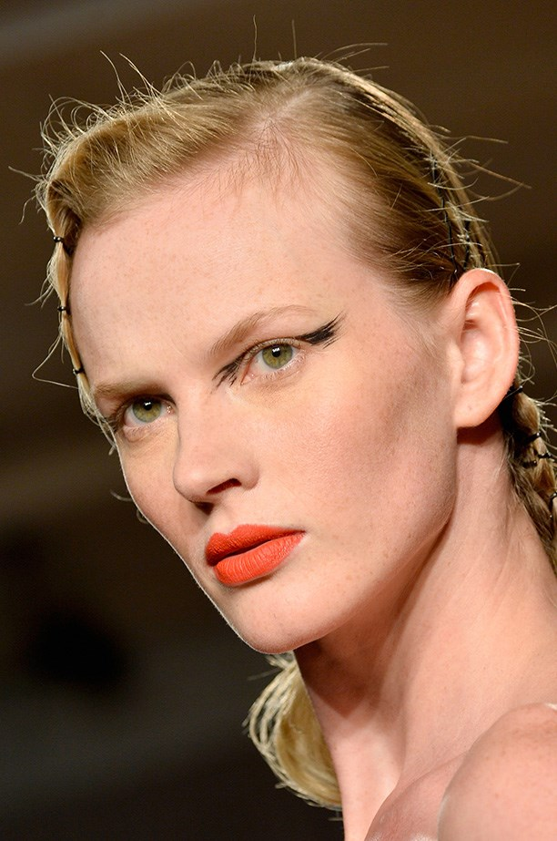 """<strong>The new winged liner<BR></strong> """"Black Swan day-time"""" was how Coco Rocha described the edgy look at Zac Posen's AW14 show.  M.A.C artist Kabuki says, """"From a distance…feel like traditional glamour. But up close, you see an intimate brush stroke."""""""