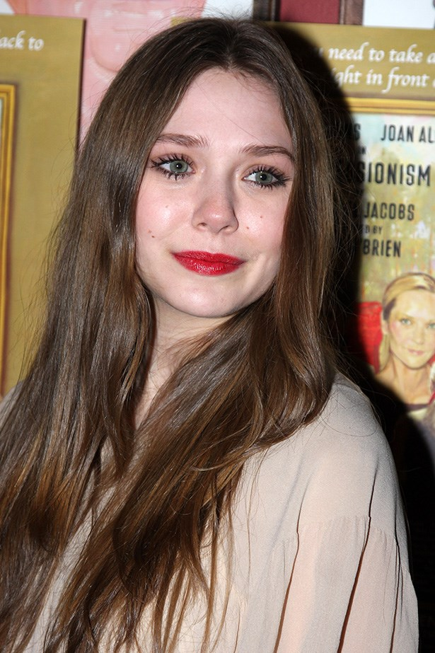 Olsen made her mark on Broadway when she won the lead role in <em>Impressionism</em>. At the premiere after party she wore her then-dark brunette hair down, with lashing of mascara and a red lip.
