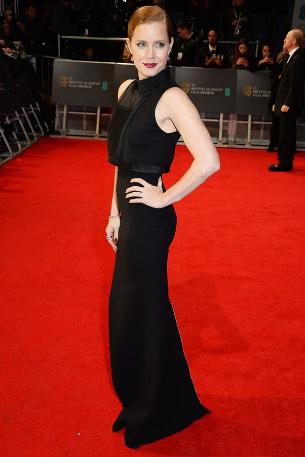 Amy Adams might have opted for a subdued colour, but she's all form-fitting vamp in this frock by Victoria Beckham.
