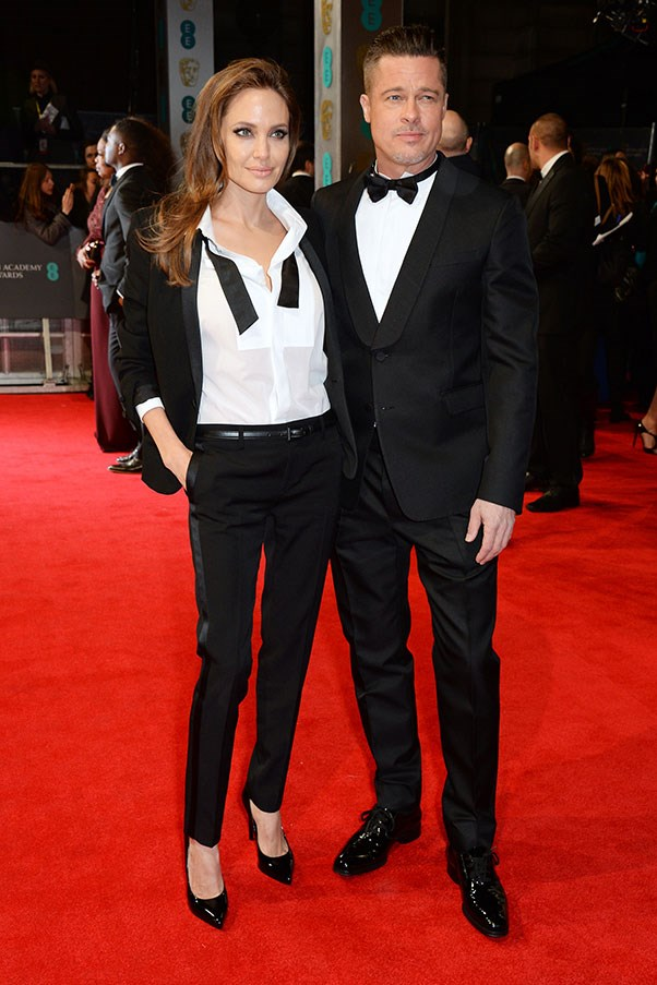 There's an old joke that Brad Pitt always begins to look like his girlfriends, but this time around it seems Angie is taking a leaf from his book in this borrowed from the boys tux by Saint Laurent.