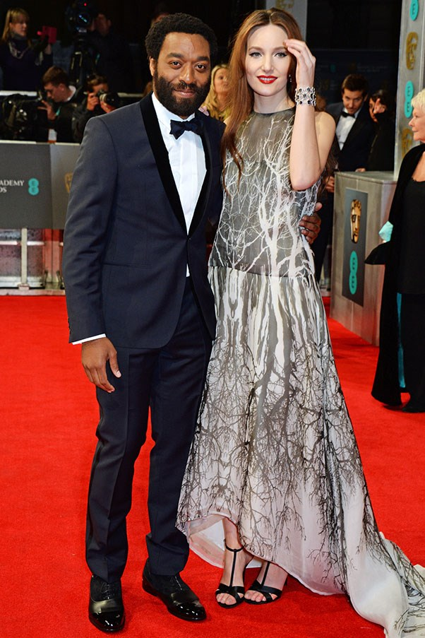 Chiwetel Ejiofor scored himself a Best Actor win meanwhile his girlfriend Sari Mercer wore a wintery printed gown and a look of pride.