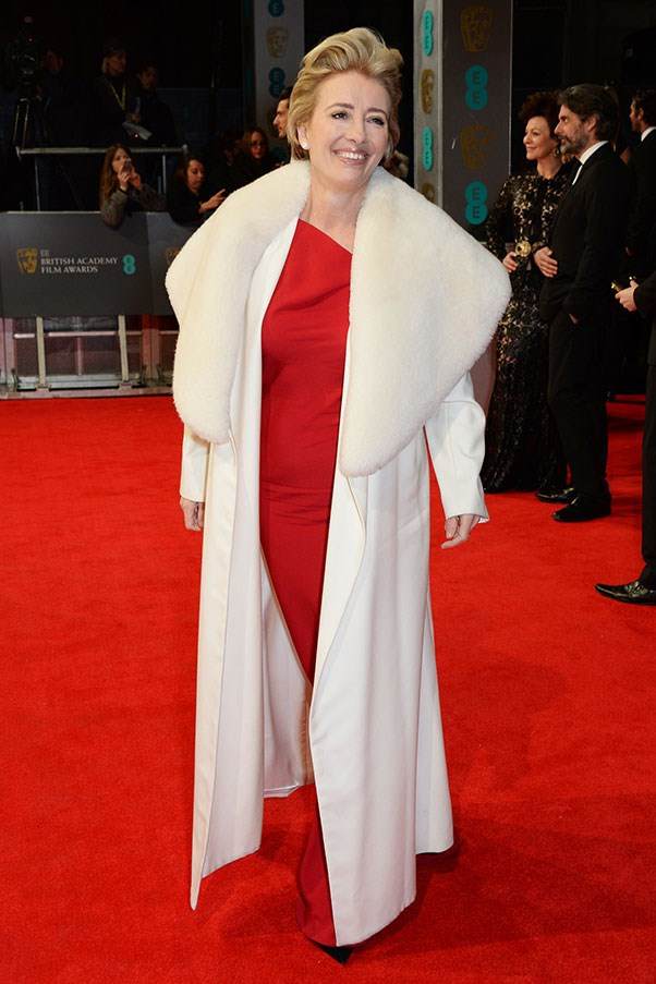 Emma Thompson decided to take a giant white sheepskin coat as her date to the BAFTAs. More people should do this. The red dress underneath is Maria Grachvogel.