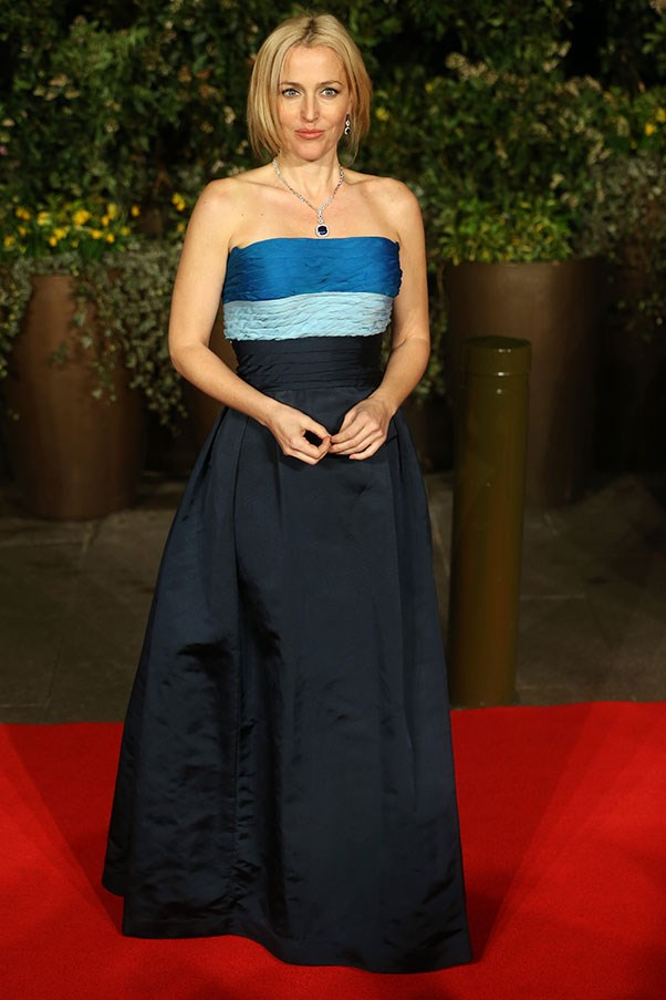 Gillian Anderson slipped into some jewel-blue vintage Balmain for the evening. Bravo.