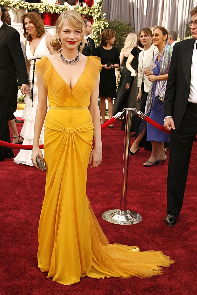 <strong>Michelle Williams, 2006</strong><br></br> A colour trend was born when Michelle donned this stunning mustard-hued Vera Wang design for the 2006 awards. Her red lips and sparking Chopard neck bling completed the look.