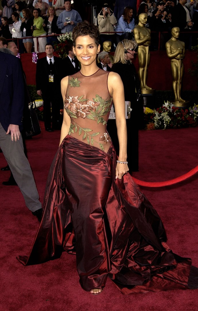 <strong>Halle Berry, 2002</strong><br></br> On the bottom half, it was classic Hollywood ball gown, but up top it was all sex appeal, with a sheer floral fabric that revealed a hint of cheeky cleavage and navel. Elie Saab became a household name after this landed on the red carpet, at least in the households of the rich and famous, anyway!