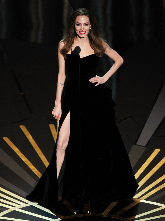<strong>Angelina Jolie, 2012</strong><br></br> You know you've made a statement when your dress gets its own Twitter handle. Her black Atelier Versace gown with dramatic thigh-high split completely overshadowed her Best Actor nominated partner, Brad Pitt. And we're OK with that.