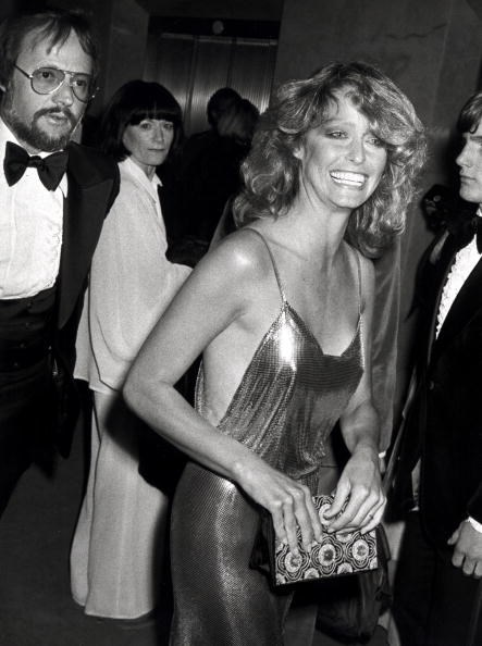 <strong>Farrah Fawcett, 1978</strong><br></br> The <em>Charlie's Angel</em> drew plenty of attention with her choice of a high-wattage, gold Stephen Burrows gown in 1978. It was sexy and confident – the perfect combination for this Californian bombshell.