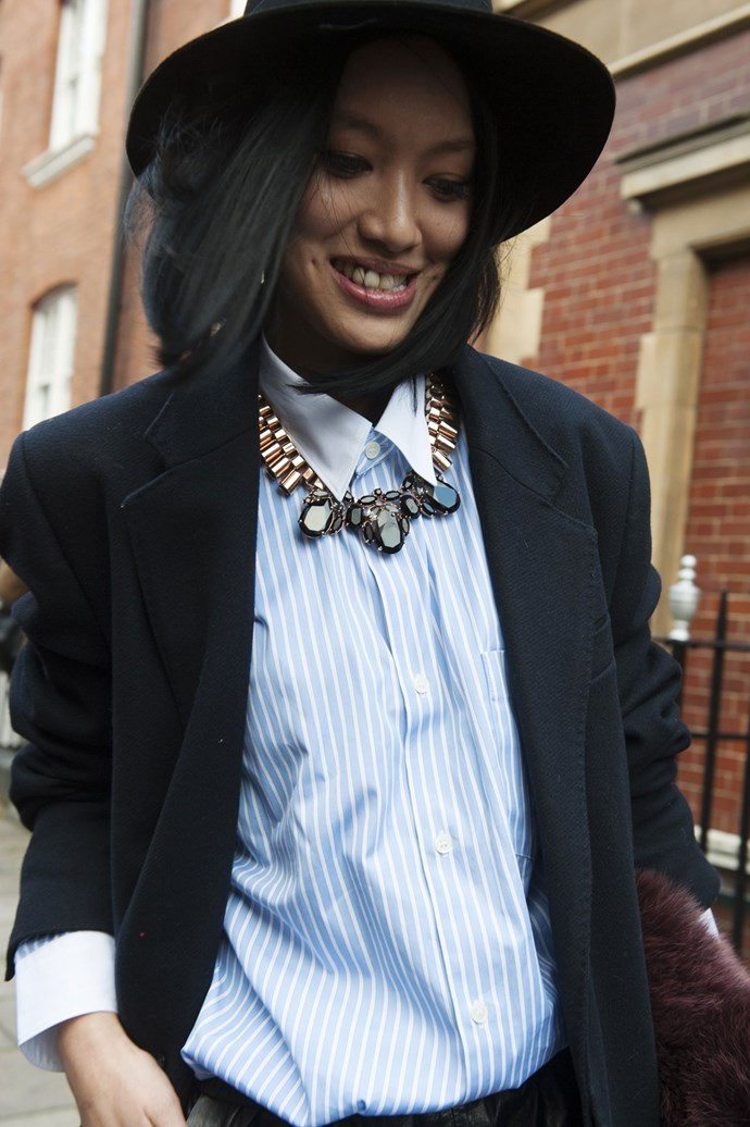 Add a touch of femininity to your wool felt fedora and sharp blazer with a statement necklace