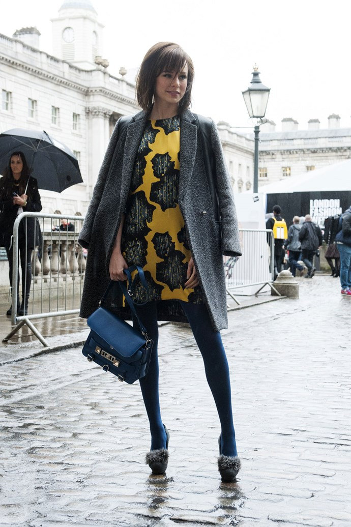Rainy days go astray with a bold yellow print dress and soft midnight blue legs, tied together with fabulous fur finished heels