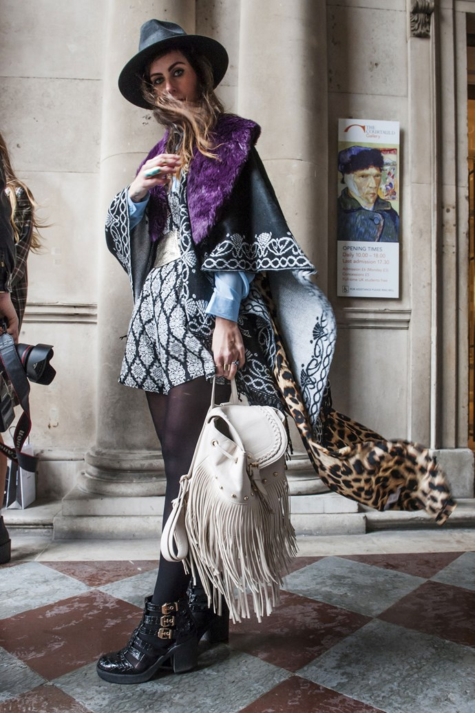 This bohemian street style star takes London Fashion Week with clashing prints, a wide-brim hat and a fringed backpack