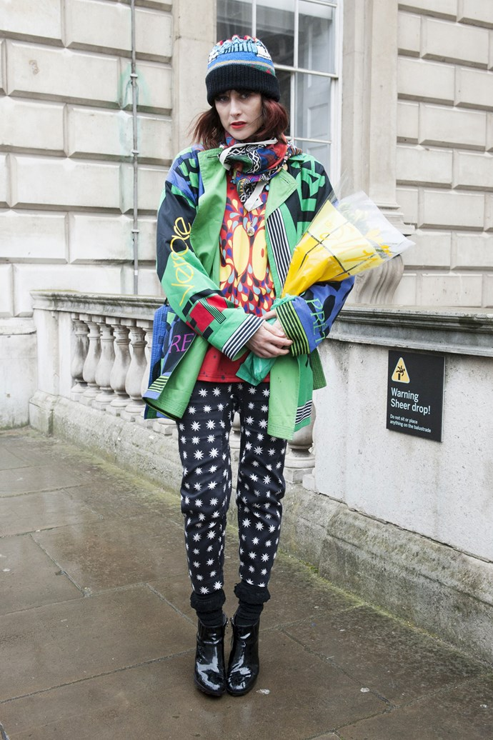 Busy colours radiate from head to waist only to be effortlessly balanced by monochrome print pants and high-gloss black boots.