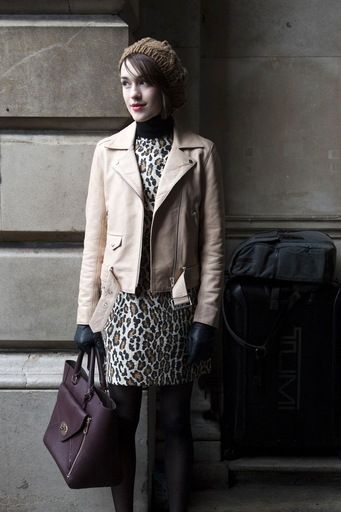 Elegance resonates with a soft beige leather jacket against a classically cut leopard print dress. Black leather gloves and a rich-hued tote give is added class.