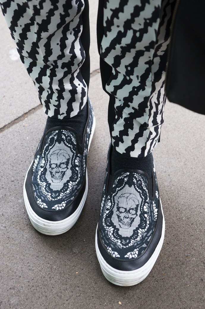 A skull pair of slip-ons make the perfect shoe for hoping from one show to another