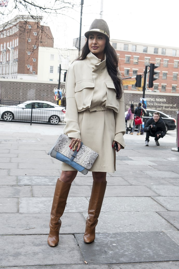 A contemporary take on the classic trench, this fashion week attendee modernised the look with a a grey marle hat, tan boots and a snakeskin clutch