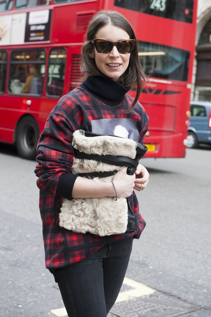 A plaid jumper and shearling clutch takes farm-girl style to fashion week