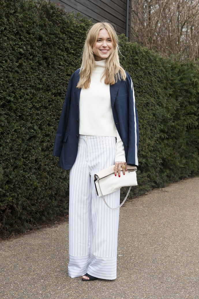 Making pajama pants look cool with a white sweater and navy over coat