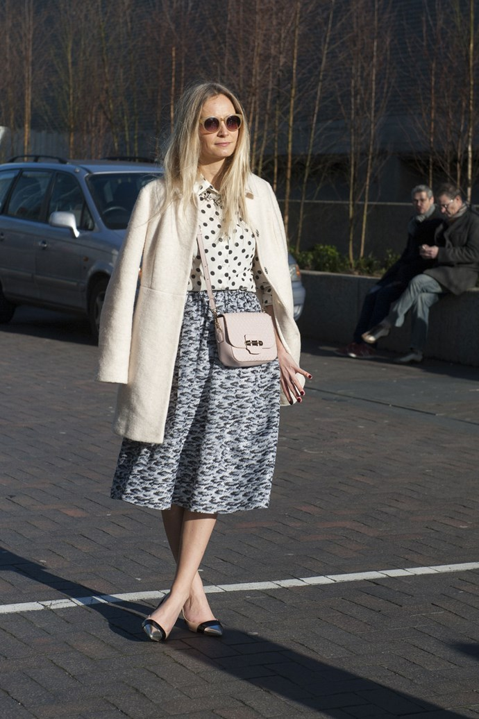 Channel <em>Mad Men's </em>Betty Draper with a 1950's take on a traditional beige trenchcoat