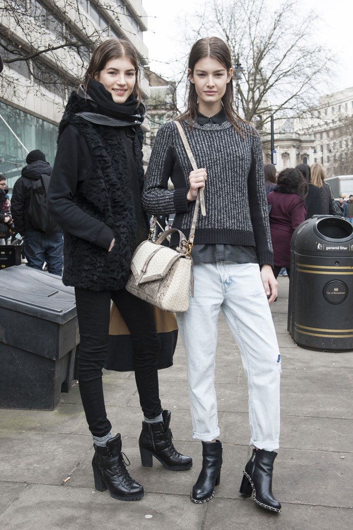 This model duo had bulbs plashing outside the AW14-15 shows. Casual denim paired with Chanel chain boots, we love...