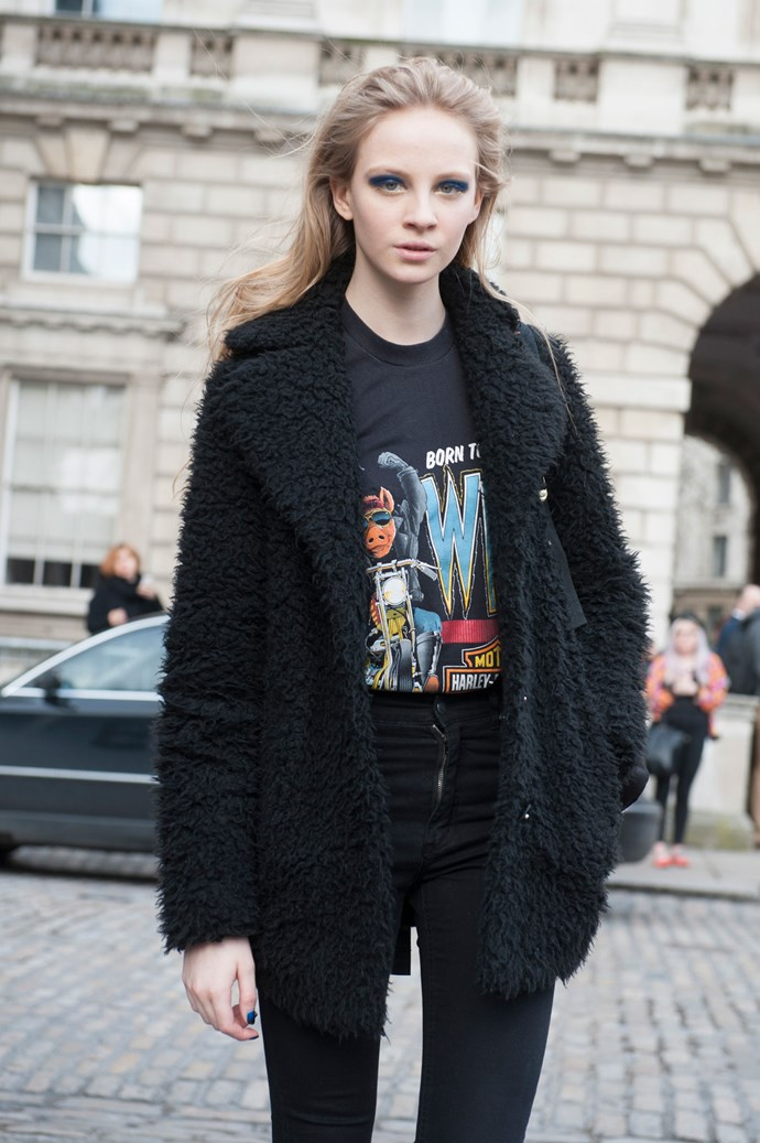 A playful novelty tee, tucked into high waisted jeans with a large, dishevelled Muppet coat is an irreverent response to freezing weather, but by keeping the look all black, it remains stylish.