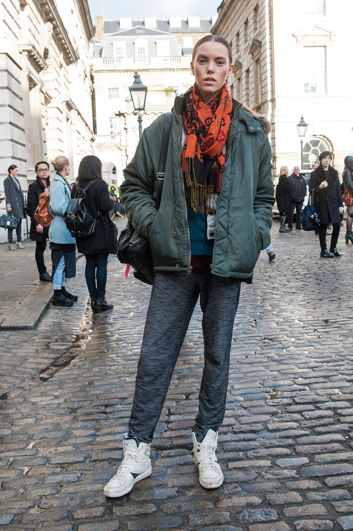 A khaki puffer, moon-boot kicks, relaxed fleecy pants with a splash of burnt orange provides military-grade warmth but with a casual, stylish twist.
