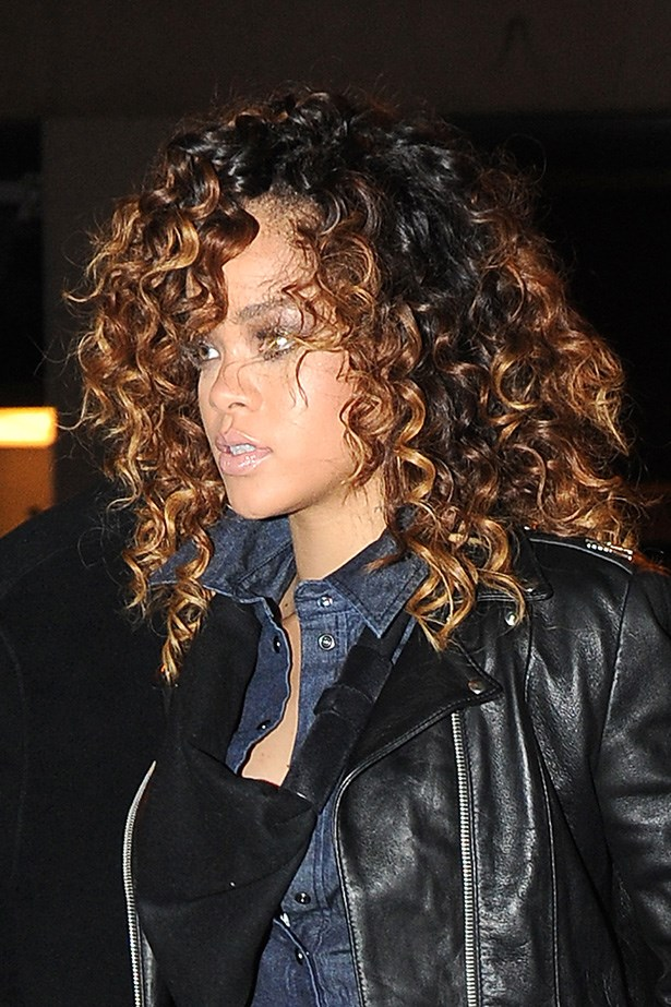 At the end of 2011, the pop star was spotted in Milan with balayaged cork-screw curls.