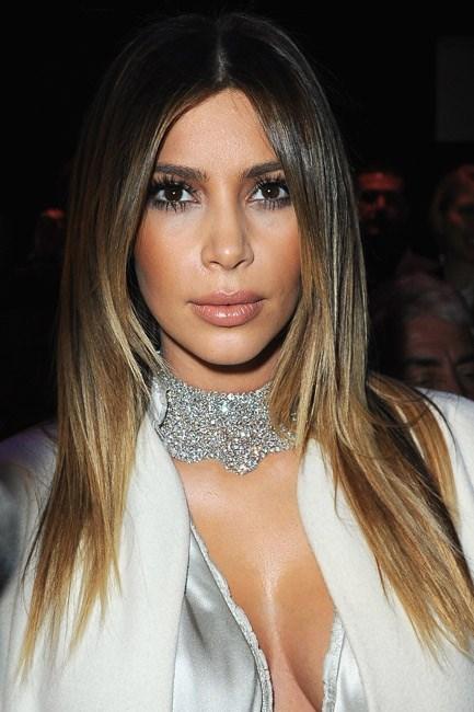 …<em>Because</em> she's Kim Kardashian, Kim Kardashian sat front row at the Stephanie Rolland spring/summer 2014 couture show <em>dripping</em> in diamonds.