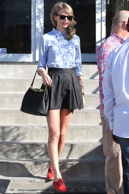 Taylor Swift matches her signature red lipstick to her footwear. The result? Major cuteness and style cred.