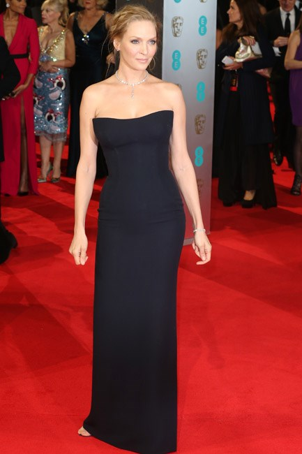 Uma Thurman was <em>va-va-voom</em> in a navy Atelier Versace strapless gown at the BAFTAs 2014.