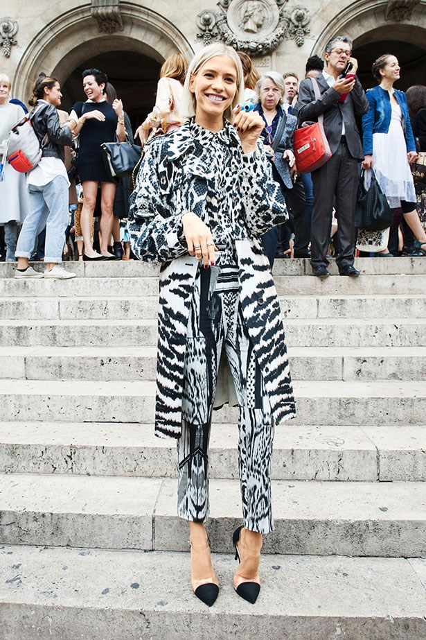 """Print-on-print doesn't appeal to everyone, but sticking to black and white makes a daring ensemble a little more attainable. Just remember to keep accessories simple and let the outfit do the talking."""