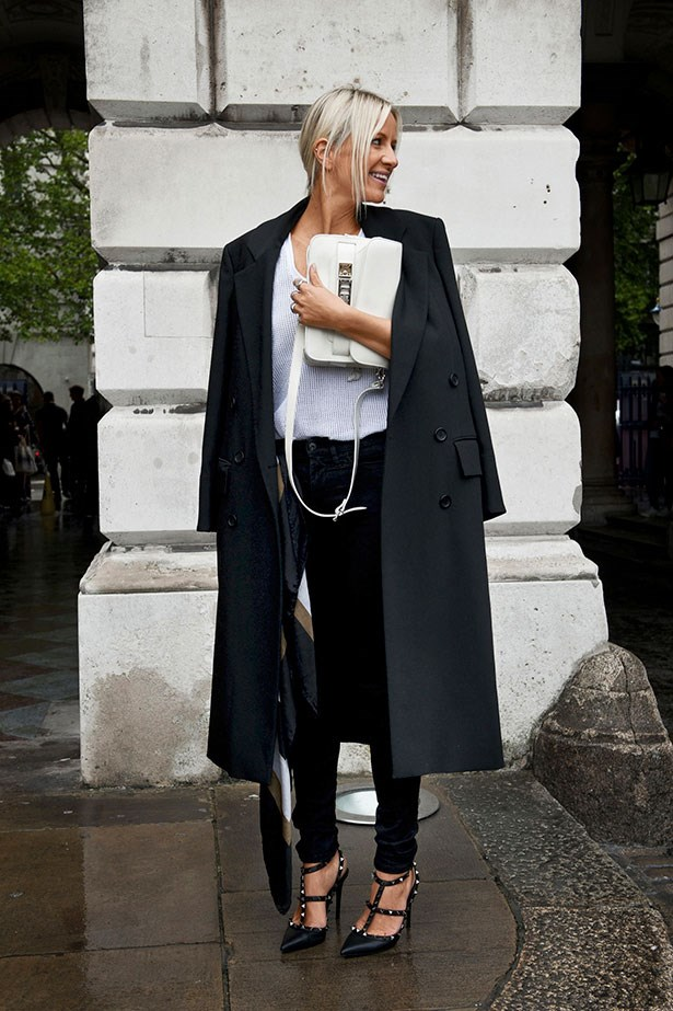 """Textured white knit, coat over the shoulders, skinny trousers, Valentino Rockstud heels and Proenza Schouler's PS11 bag in classic white: this look ticks all the boxes for effortless chic."""