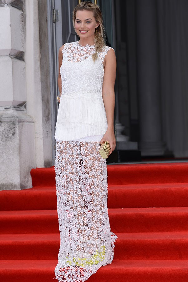 In August of last year, Robbie wore a lacy white Ermanno Scervino gown to the world premiere of <em>About Time</em>.