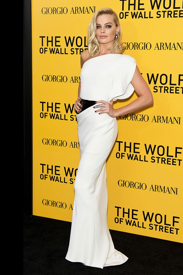Then, in the evening, she changed into a dazzling white and black Armani Prive gown.